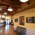 inside lobby area with pictures and bench in georgetown airport